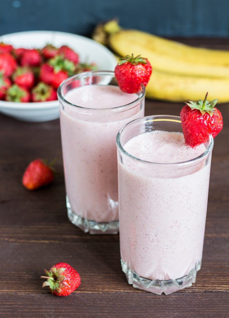 Strawberry banana smoothie healthy breakfast drink in glass
